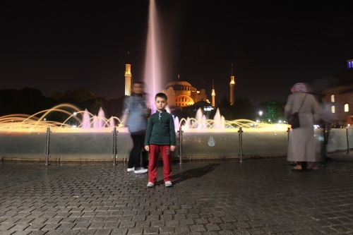 A kid stood still for me in front of the Aya Sofya (Hagia Sofia)