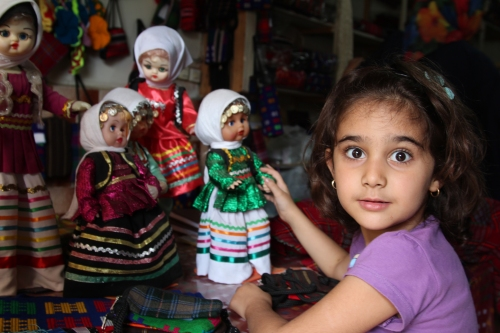In the Caspian province of Gilan, my friend Zia's friend's daughter Vanusheh plays with dolls dressed in typical Gilani dress. The dress (and Vanusheh) show that Iranians are far more lively, colourful and cheeky than the Islamic Republic would like us to believe. Iranians in general don't feel part of the Islamic Republic  - at best they have learned to work around the government's entrenched corruption and criminality in the name of god - but a great many despise it and wake up each morning wanting it gone.