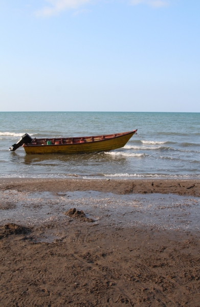 A boat on the Caspian Sea. The sand is dark and sometimes pebbly, and the waves aren't great. But this lush green region in the north is where many Iranians come to get away from the dry heat of the country.