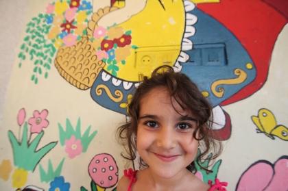 Vanusheh outside her kindergarten after school