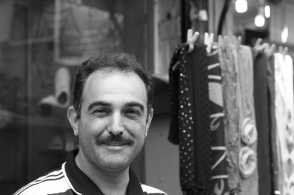 "This man selling textiles in the Rasht bazaar shouted to us ""Hey! Come take a picture of me!"""