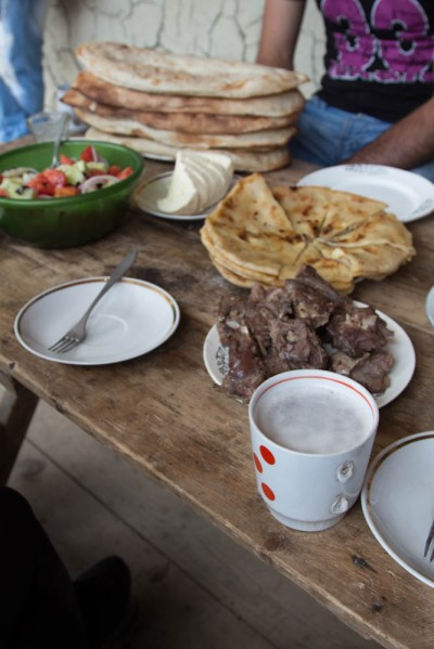 An impromptu lunch offer from Alika, who gave us a lift from Omalo to Dartlo. The pizza-looking dish is Khachapuri, a typical Georgian cheese bread. After lunch we and his family piled into his Hilux for the ride to Omalo. They were moving back to Kakheti for the long Tushetian winter.