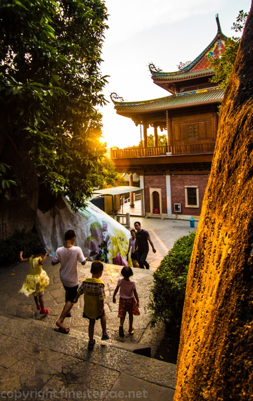Kids at sunset at Xiamen's Nanputuo Temple.