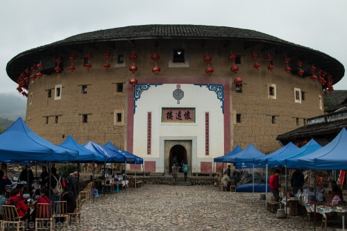 The heavily-touristed Huaiyuanlou building, with souvenir sellers lining the approach.
