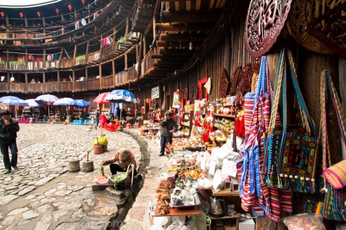 Many of the tulou have been turned over to government-approved tourist attractions so their ground floors, previously used for cooking, are now souvenir shops.